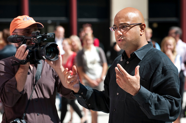 CNN's chief business correspondent Ali Velshi (at right in black shirt) ask questions of UW–Madison students commenting about the state of the American economy as a CNN Express video crew tapes the town hall-style meeting in the courtyard of Grainger Hall at the Wisconsin School of Business.