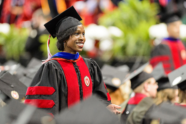 Catasha Davis, who holds an M.A. inMA in Journalism, among other advanced degrees, at a UW–Madison commencement ceremony.