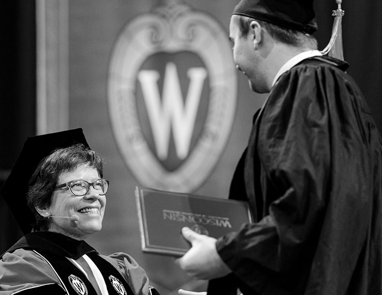 Graduate receiving a diploma from the chancellor