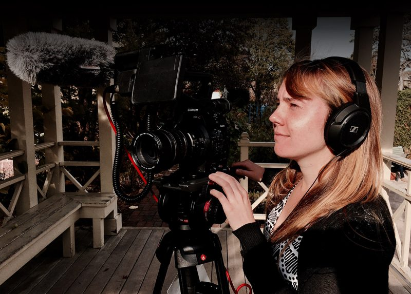 Melissa Behling films from behind a video camera.