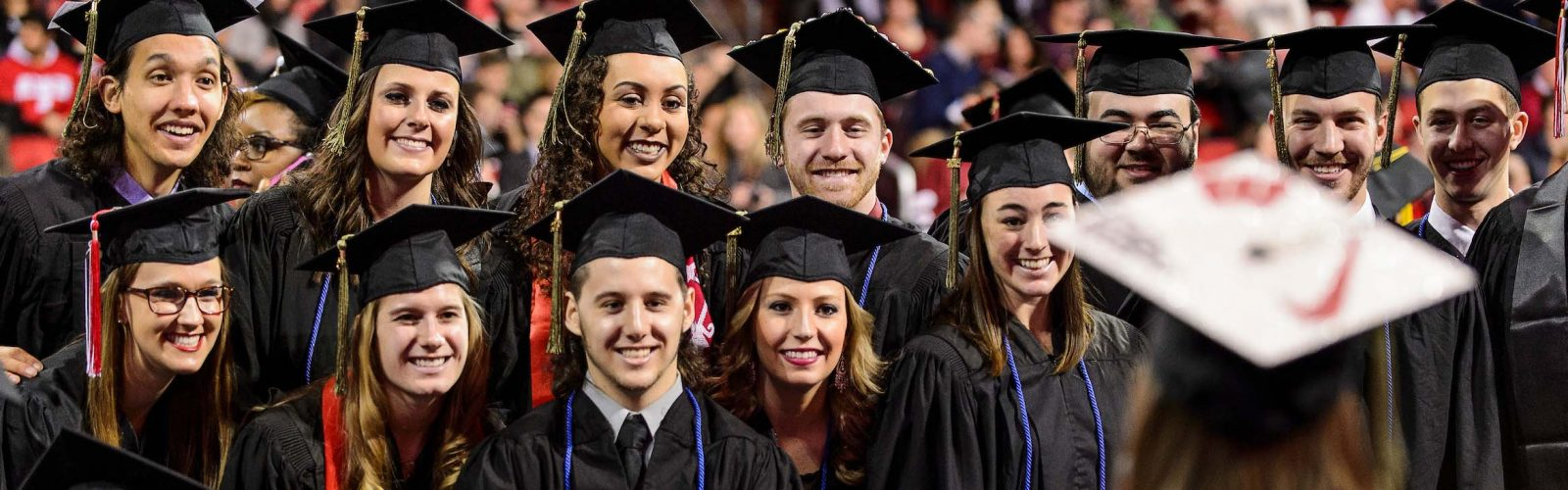 A group of graduates pose for a photo during UW-Madison's winter commencement ceremony at the Kohl Center at the University of Wisconsin-Madison on Dec. 20, 2015. The indoor graduation was attended by approximately 1,200 bachelor's and master's degree candidates, plus their guests. (Photo by Jeff Miller/UW-Madison)