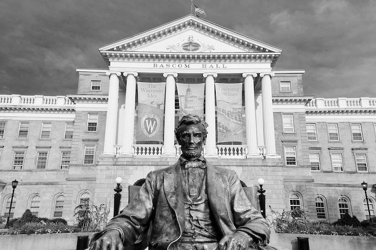 A statue of Abraham Lincoln sits in front of Bascom Hall atop Bascom Hill.