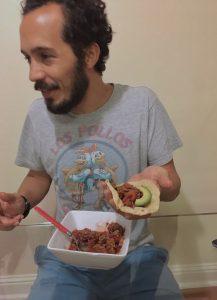 Carlos Dávalos eating tacos