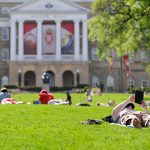 People relax and study on Bascom Hill at the University of Wisconsin-Madison during spring.