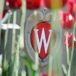 Flowering red tulips frame an ornate W crest icon that is a part of a landscaped roundabout at Observatory Drive and Walnut Street at the University of Wisconsin-Madison during spring on May 24, 2013. (Photo by Jeff Miller/UW-Madison)