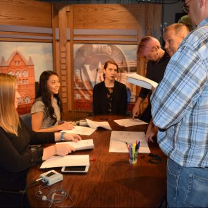 Badger Report students Alesha Guenther, Alyssa Hui, Caitlin Rowe and Vera Rosenback prepare to go live with the help of newscast director Peter Kleppin and PBS Wisconsin's Kurt Kaspar.