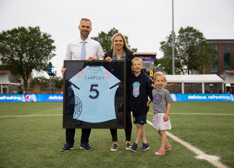 J-School Alum and Forward Madison FC COO Conor Caloia welcomes Olympic gold medalist Lindsay Tarpley during Women in Soccer Night last June in Madison, Wisconsin (Will Jenkins / Photo)