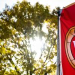 A W crest banner flutters in the wind on Bascom Hill at the University of Wisconsin-Madison during autumn on Oct. 18, 2019. (Photo by Jeff Miller /UW-Madison)