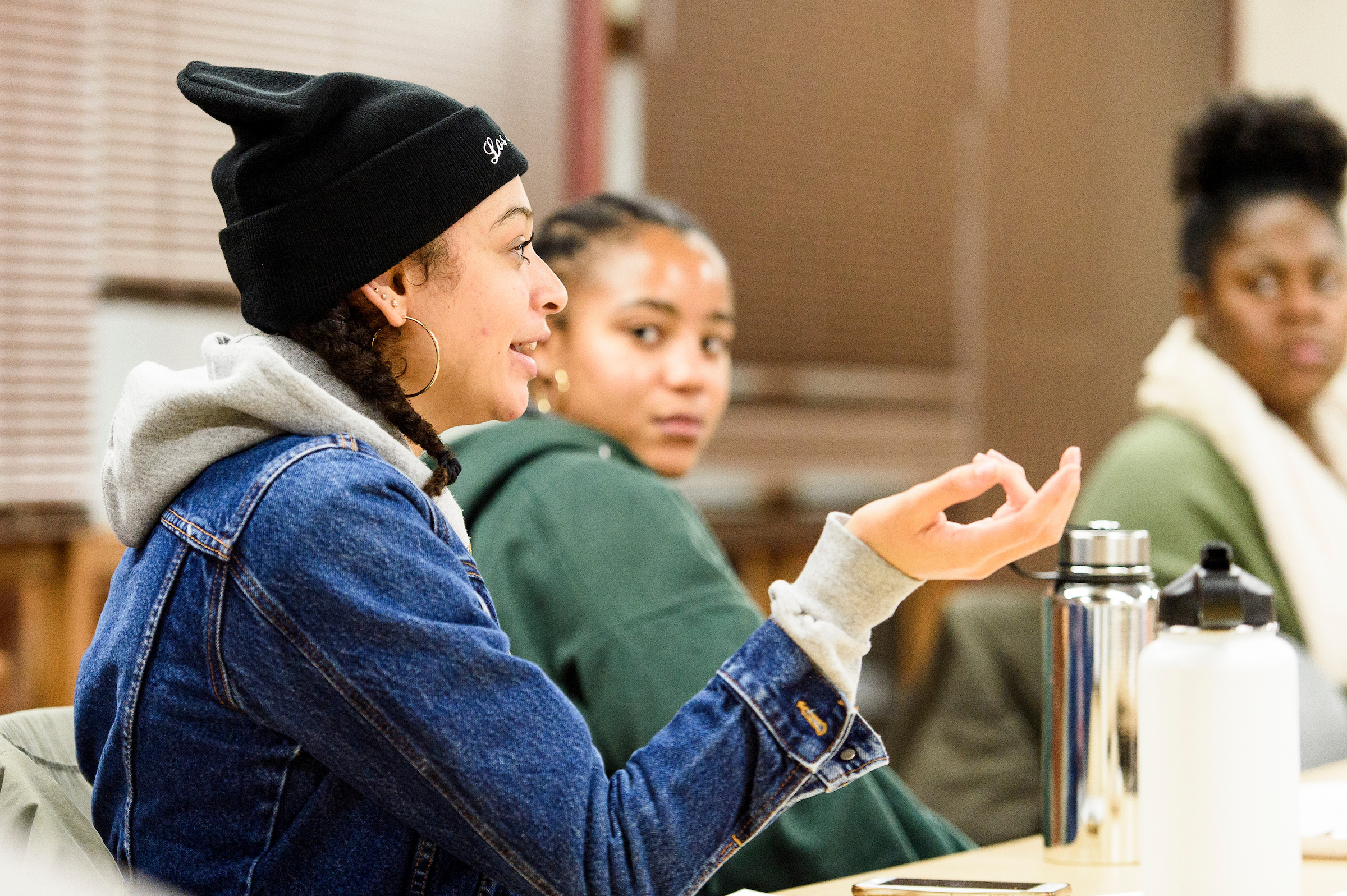 Students from The Black Voice discussing a multimedia project