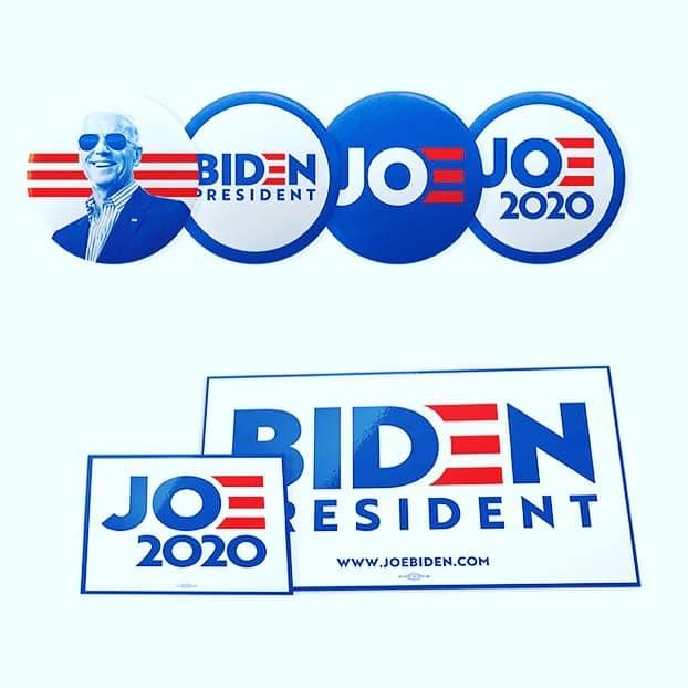 Buttons and stickers with Joe Biden's logo and branding on them.
