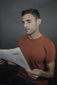 Jacob Kushner reading a newspaper