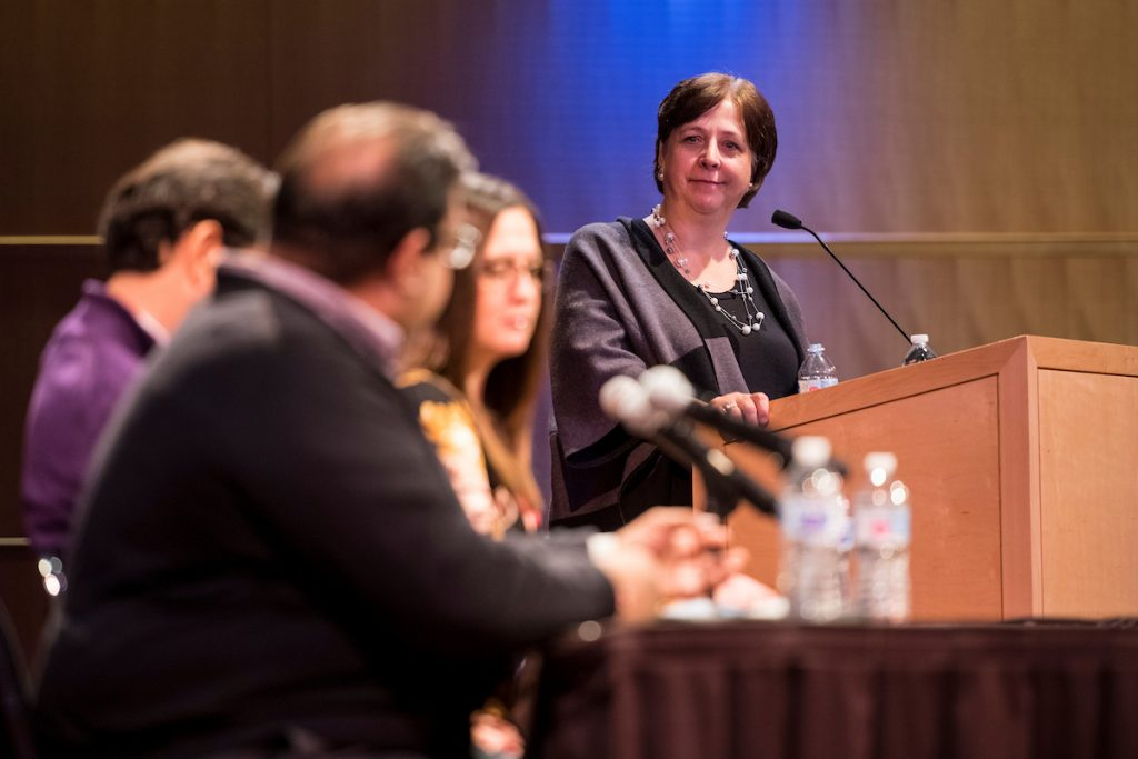 Prof. Katy Culver moderates a panel discussion