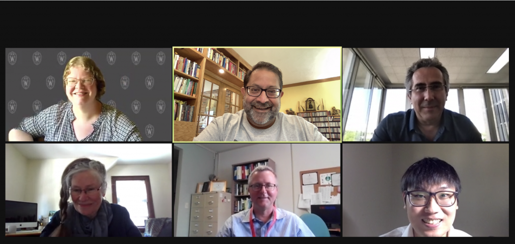 A Zoom call with six people smiling