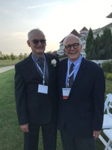 Jack Mitchell and Jim Hoyt stand together outside the Blue Harbor Resort in Shebooygan, WI