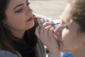 Mather applies makeup to model for Trek Bicycle shoot