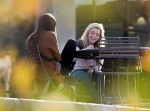 Undergraduates Cady Gansen, left, and Hannah Rosso, relax, study and talk at table outside Gordon Dining and Event Center at the University of Wisconsin-Madison during autumn on Oct. 16, 2014. (Photo by Jeff Miller/UW-Madison)